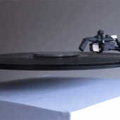 Electromagnetic floating record player