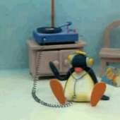 Penguin listening to records