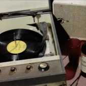 Retro record player and a bottle of wine