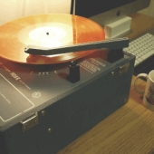 Vintage record player by a coffee